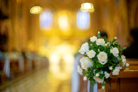 white flower with blur church background wedding ceremony Banco de Imagens