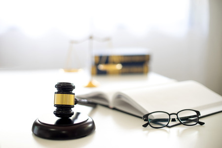 Judge lawyer gavel work in office with balance in law firm concept Stock Photo