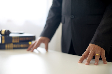 chairman or head of justice  lawer stand at the table with balance and gavel Stock Photo