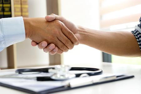 professional doctor handshake to the patient after they have good advice for the good health 写真素材