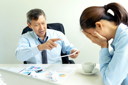 businessman and businesswoman sit quarrel at the table fill sad and headache , concept business failure or problem 写真素材