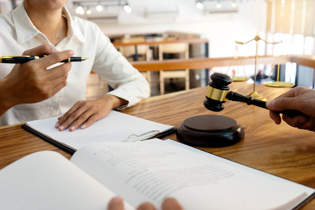 Judge or lawyer talking with team or client about consult law detail, law firm concept. Stock Photo
