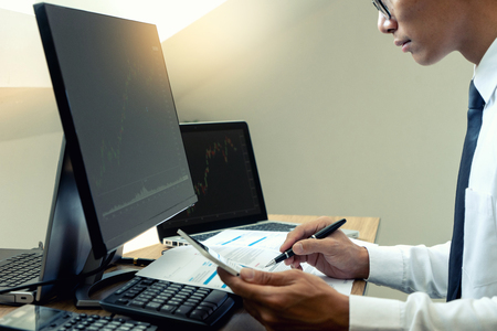 business man sit at ther table looking at computer laptop in the office