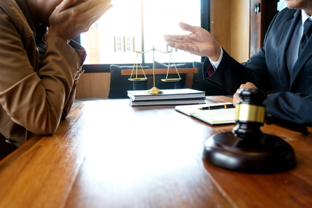 Judge or lawyer talking  with client who feel sad about consult law detail, law firm concept