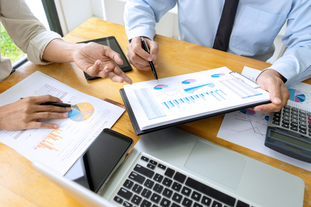 Business meeting businessman and colleagues conference professional investor working a new marketing business strategy project discussion and analysis data chart and graph, finance and accounting concept.