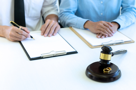 Judge work at the table talk with wife husband about the marry law , show the ring balance  gavel Stock Photo