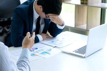 businessmans sit quarrel at the table fill sad and headache , concept business failure or problem