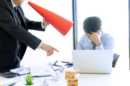 Boss angry and use red Megaphone shouting at his workers staff  who can not done good job. Worker feeling despair avoiding bothering clients. Imagens