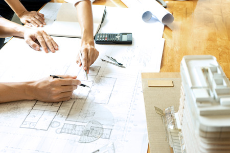 engineer or architectural project, two engineering or architecture discussing and working on blueprint with architect equipment, Construction concept.