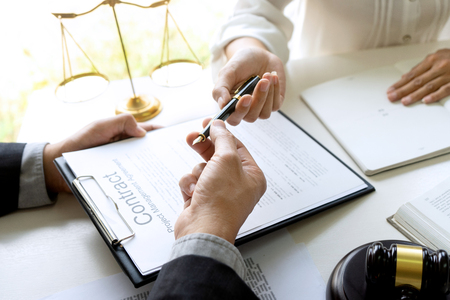 Judge or lawyer send pen to team or client about consult law detail and prepare to sign contract agreement, law firm concept. Banque d'images - 124946701