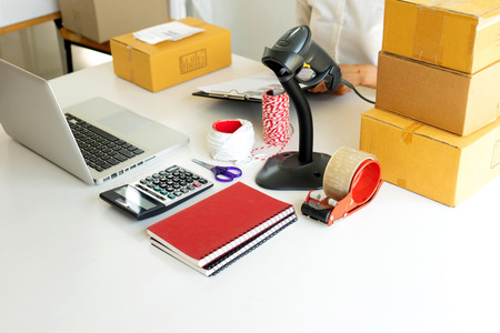 Small business Worker  delivery service and working packing box, business owner working checking order to confirm before sending customer in post office, photo show packing equipment Imagens