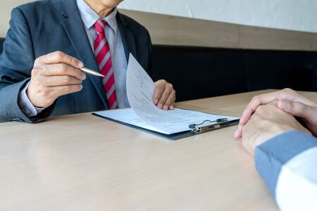 Job interview businessman listen to New staff  candidate answers in office - recruitment process concept Фото со стока