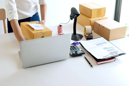 Small business Worker  delivery service and working packing box, business owner working checking order to confirm before sending customer in post office, Shipment Online Sales Imagens