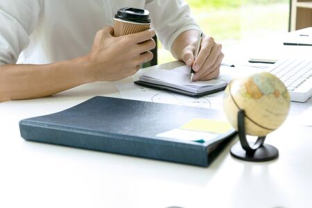 woman and man work for education or business on the table with notebook laptop and paper work color pen Stock Photo