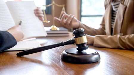 Judge gavel with Justice lawyers, Businessman in suit or lawyer working with legal law documents. advice and justice law firm concept. crop 16:9 Stock Photo