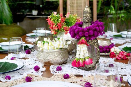 Thai food table decoration silver ware flower garland