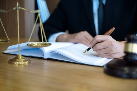 lawyer or  judge work in the office with gavel and balance