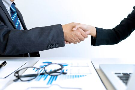 businesswoman and businessman shaking hands Business partnership Collaborative teamwork concept 写真素材 - 124952112