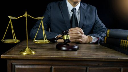 Judge lawyer gavel work in office with  balance  in law firm concept crop to 16:9