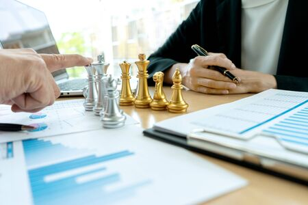 Businessman play chess on the marketing work place on office table for concept to win in strategy. Banco de Imagens