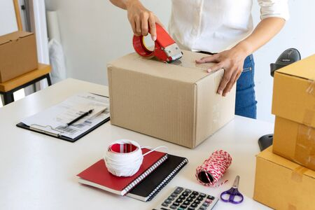 Small business Worker  delivery service and working packing box, business owner working checking order to confirm before sending customer in post office, Shipment Online Sales 版權商用圖片