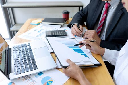 Businessman coaching office staff for business marketing plan Imagens