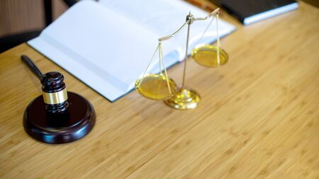 Lawyer firm office, gavel and balance on the table with book background concept law firm crop 16:9 写真素材