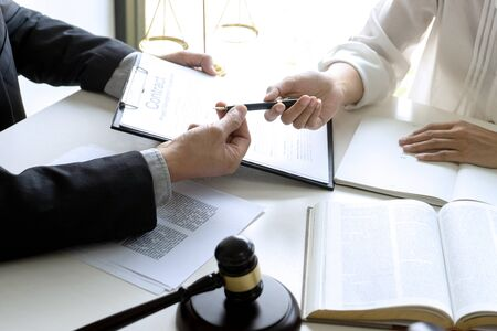 Judge or lawyer talking  with team or client about consult law detail and prepare to sign contract agreement, law firm concept. Banco de Imagens - 128487466