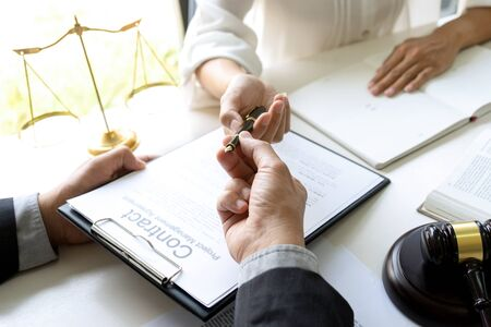 In the office Judge or lawyer talking  with team or client about consult law detail and prepare to sign contract agreement, law firm concept.