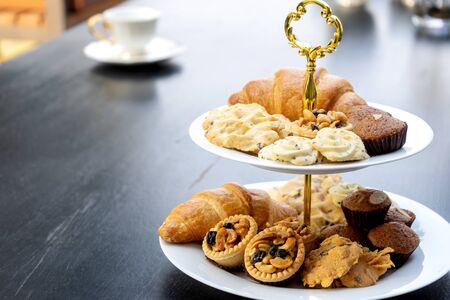 High tea set are on the black table be outdoor. Foto de archivo