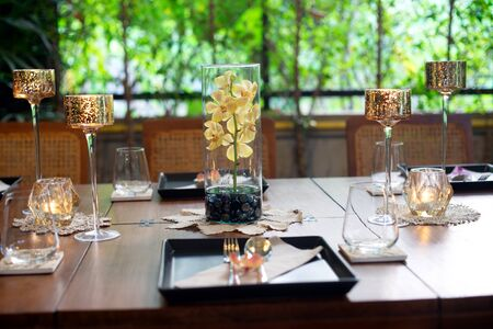 Dinner set on the wood table with long wine glass ware. Banco de Imagens