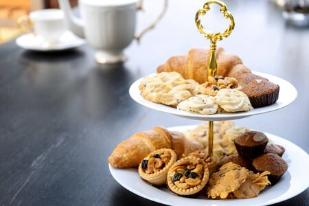 High tea set are on the black table be outdoor. Stock Photo
