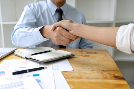 Businessman  handshake and business people after discussing good deal of Trading contract and new projects for both companies, success, partnership, co worker . Meeting and greeting concept.