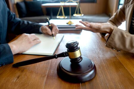 Judge gavel with Justice lawyers, Businessman in suit or lawyer working with legal law documents.  advice and justice law firm concept.