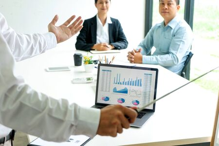 Young businessman stand in front of the group to present or business coaching to teach the technic to marketing business reach the target. Stock fotó