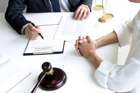 Judge or lawyer talking  with team or client about consult law detail and prepare to sign contract agreement, law firm concept.