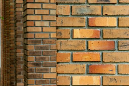 Many layer of old brick pole. Background brown orange color sepia old tone. 写真素材
