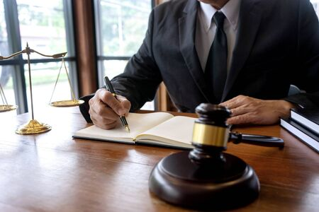 Judge lawyer gavel work in office with  balance  in law firm concept