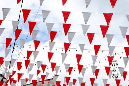 sky with many line of flag red and white decor over the street to show celebration festival