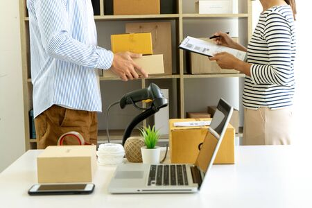ecommerce concept, in office or home working prepare product in the box for send to customer who order by online. box for logistic with barcode scanner