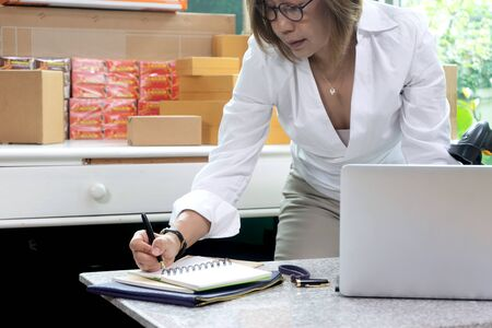 Small business woman Worker delivery service and working packing box, business owner working checking order to confirm before sending customer in post office, Shipment Online Sales Imagens