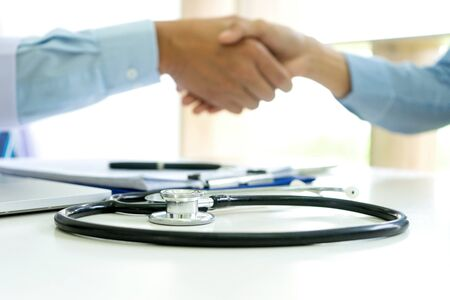 professional doctor handshake to the patient after they have good advice for the good health Imagens
