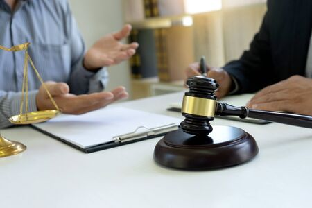 Judge or lawyer talking  with team or client about consult law detail, law firm concept.