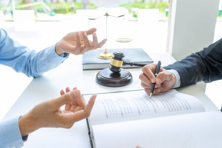 in office  Lawyer or judge gavel with balance work with client or customer about agreement how to  use arbitration