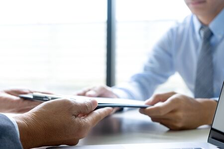 Businessman group in office, young asian people sit and speaking with resume while interviewing as candidate for job in big company.