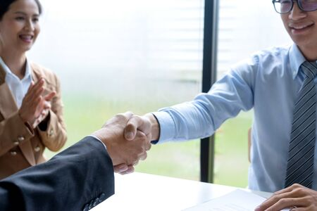 Successful business job interview, Young attractive asian employee handshaking with boss