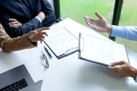 Businessman group in office, young asian people sit and speaking with resume while interviewing as candidate for job in big company. career and recruitment concept Stock Photo