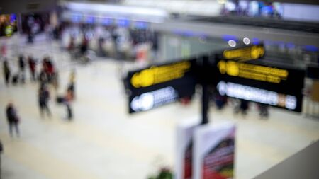 blur image of signboard and hall in the airport teminal.