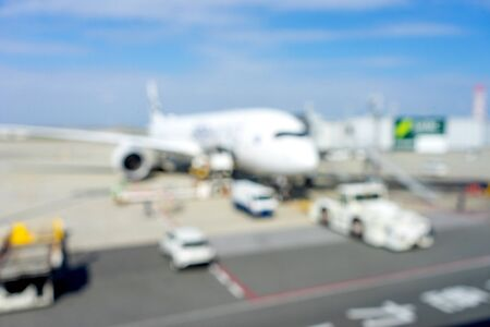 blur image of airplane in the airport runway 写真素材