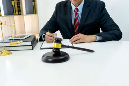 Lawyer or Judge work in the office  gavel and balance on the white table. with more copy space Standard-Bild
